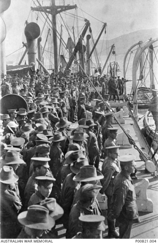 OFF LEMNOS ISLAND, 1915-04-24. COLONEL ROSENTHAL SPEAKING TO 7TH BATTERY, 3 BRIGADE ARTILLERY COLUMN, ABOARD SHIP JUST BEFORE LEAVING LEMNOS ISLAND FOR THE DARDANELLES AND THE GALLIPOLI LANDING. (DONOR: P. SMITH, ESTATE OF R.C.N. SMITH) AWM P00821.004
